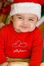 Baby in Christmas Cloths Stock Photos