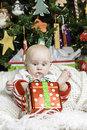 Baby christmas portrait a infant set with a holiday scene Stock Photos