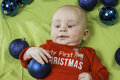 Baby christmas portrait a infant set with a holiday scene Royalty Free Stock Photo