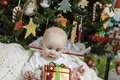 Baby christmas portrait a infant set with a holiday scene Royalty Free Stock Photos