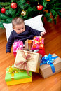 Baby with Christmas presents Royalty Free Stock Photos