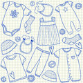 Baby clothes doodles on school squared paper Stock Photos