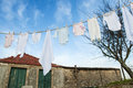 Baby clothes on line outside in rural garden Royalty Free Stock Photo