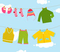 Baby clothing on clothespin Royalty Free Stock Images