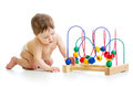 Baby with color educational toy boy Royalty Free Stock Image