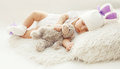 Baby comfort! Sweet infant at home sleeping with teddy bear