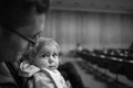 Baby concert in a hall with dad looking on Royalty Free Stock Image