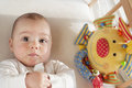 Baby in cot Stock Image