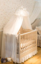 Baby cot wooden with curtain Royalty Free Stock Photos
