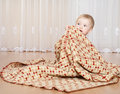 Baby covering with a blanket Royalty Free Stock Image