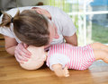 Baby cpr check for signs of breathing woman performing on training doll checking Stock Photo