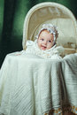 Baby in cradle cheerful and happy blue eyed bonnet lies Stock Photography