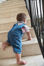 Baby crawling alon on stairs Stock Image
