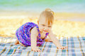 Baby crawling on the beach Royalty Free Stock Photo