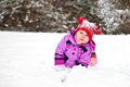 Baby crawling in winter Royalty Free Stock Photo