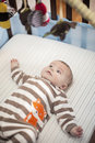 Baby in crib boy looking at mobile hanging above Stock Photography