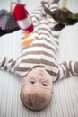 Baby in crib boy with mobile Royalty Free Stock Photography