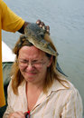 Baby Crocodile on the Woman's Head Royalty Free Stock Image