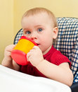 Baby with cup Royalty Free Stock Photo