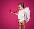 Baby cupid with a bow arrow and wings Stock Photo