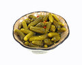 Baby Dill Pickles in Dish Stock Image