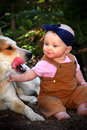 Baby in Dirt with Dog Royalty Free Stock Photo