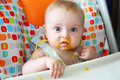 Baby with dirty mouth after eating Stock Photos