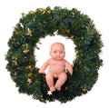 Baby doll angel boy sitting on christmas wreath isolated white Stock Photo