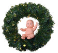 Baby doll angel boy sitting on christmas wreath isolated white Stock Images