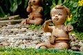 Baby dolls made of clay, used for garden decoration.