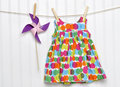 Baby Dress and Pinwheel on a Clothesline Stock Image