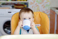 Baby drink from baby cup happy boy age of year Royalty Free Stock Images