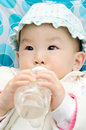 Baby drink water Stock Image
