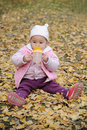Baby drink water in autumn Royalty Free Stock Images