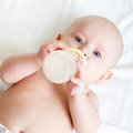 Baby drinking from bottle pretty girl milk Royalty Free Stock Image
