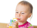 Baby drinking juice from straw Stock Photography