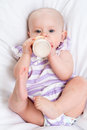 Baby drinking milk from bottle adorable child Royalty Free Stock Image