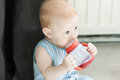 Baby drinking water from bottle cup Stock Photography
