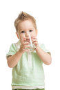 Baby drinking water from glass on white Stock Photos