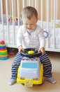 Baby drives baby car Royalty Free Stock Photo