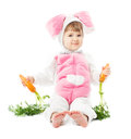 Baby in easter bunny costume with carrot, kid girl rabbit hare Royalty Free Stock Photo