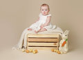 Baby with easter bunny and eggs beautiful sitting up on a a blanket Royalty Free Stock Photo