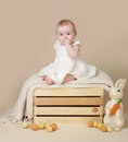 Baby easter bunny eggs beautiful sitting up on a a blanket with and Royalty Free Stock Images
