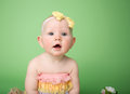 Baby in easter outfit looking up colors and flowers Royalty Free Stock Photography