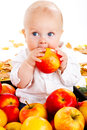 Baby eating apple Stock Image