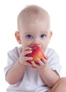 Baby eating apple Royalty Free Stock Photography