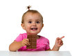 Baby eating chocolate isolated on white Stock Image