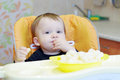 Baby eating corn curls lovely age of year Stock Photography