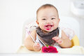 Baby eating dragon fruit girl red Royalty Free Stock Photos