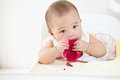 Baby eating dragon fruit girl red Stock Photo